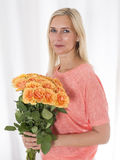 Blond woman with roses Royalty Free Stock Photos