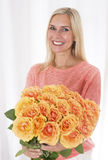 Blond woman with roses Royalty Free Stock Images