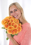 Blond woman with roses Stock Photo