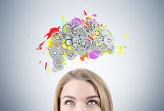 Blond woman s head and brain with gears Stock Photo