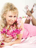 Blond woman with Sakura flowers Stock Photos