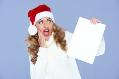 Blond woman in Santa Hat is in hudge shock Stock Images