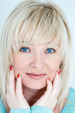 Blond woman with sapphirine eyes Royalty Free Stock Photography