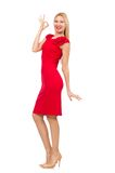 Blond woman in scarlet dress isolated on the white Stock Image