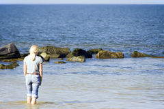 Blond woman at sea Stock Photography