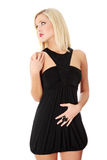 Blond woman in sexy dress. Beautiful blond woman in sexy elegant black dress, isolated on white background Stock Image