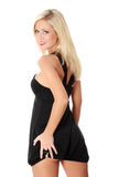 Blond woman in sexy dress Stock Photos