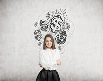 Blond woman and shining dollar signs Royalty Free Stock Photography