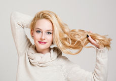 Blond woman with shiny hair. Portrait of a beautiful blond woman with nice full shiny hair Royalty Free Stock Images