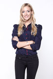 Blond woman in shirt and trousers Stock Photo