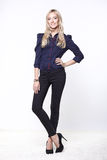 Blond woman in shirt and trousers. Lovely blond woman in shirt and trousers Stock Image