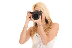 Blond woman shooting picture Royalty Free Stock Image