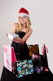 Blond woman with shopping bags and gift Stock Images