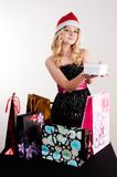 Blond woman with shopping bags and gift Stock Photo