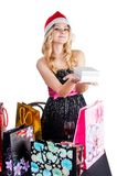 Blond woman with shopping bags and gift Royalty Free Stock Photo