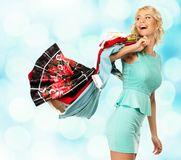 Blond woman with shopping bags Royalty Free Stock Photos
