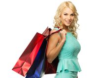 Blond woman with shopping bags Stock Images