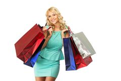 Blond woman with shopping bags Royalty Free Stock Photography
