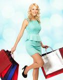 Blond woman with shopping bags Royalty Free Stock Photo