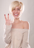 The blond woman with short hair and a beautiful smile with the index finger  isolated Stock Photo