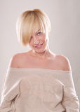The blond woman with short hair  emotions expressive. On the white background Stock Photo