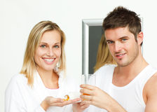 Blond woman showing her medication Stock Photo