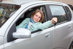 Blond woman showing ignition key. Blond hair woman showing ignition key Stock Photo