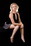 Blond woman sitting stock photo