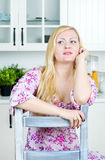 Blond woman sitting on the chair Royalty Free Stock Photos