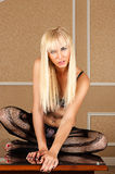 Blond woman sitting in lingerie legs crossed Royalty Free Stock Photography