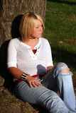 Blond Woman Sitting On Ground Royalty Free Stock Photo