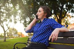 Young lady outside in a park stock photography