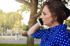 Young lady outside in a park stock photos