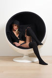 Blond woman sitting in round chair with underwear. Portrait of a blond woman sitting in round chair with underwear Royalty Free Stock Photo