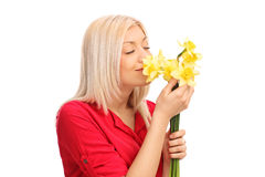 Blond woman smelling a bunch of tulips Royalty Free Stock Images