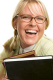 Blond Woman Smiles & Carries Stack of Books Stock Image