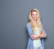 Blond woman smiling with arms crossed Royalty Free Stock Images
