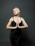 Blond woman stand with dagger - evening dress Stock Photos
