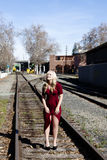 Blond Woman Standing On Rail Road Tracks Red Dress Stock Photos