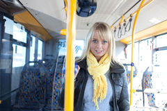 Blond woman stands inside a bus Stock Photography