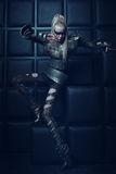Blond woman in steel armor posing Stock Images