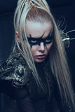 Blond woman in steel armor posing Royalty Free Stock Photo