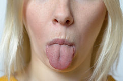 Blond Woman Sticking her Tongue Out Stock Photography