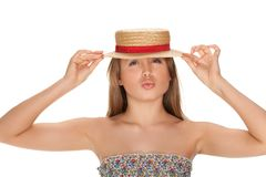 Blond woman and straw bonnet Royalty Free Stock Photography