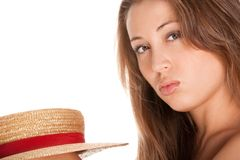 Blond woman and straw bonnet Stock Images