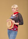 Blond woman and straw bonnet Stock Photos