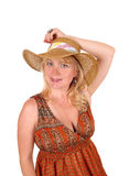 Blond woman with straw hat. A portrait image of a pretty blond woman in a dress wearing a straw Stock Photography