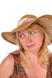 Blond woman with a straw hat. A portrait image of a pretty blond woman in a dress wearing a straw Royalty Free Stock Image