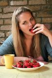 Blond Woman and Strawberry Temptation! Royalty Free Stock Photos