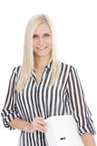 Blond Woman in Striped Shirt Holding Binder. Portrait of Smiling Blond Woman Wearing Striped Shirt and Carrying Binder in Studio with White Background Stock Photography